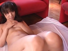 Breasty Asian charms a palpitating pecker with wet engulfing